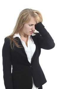 Stressed businesswoman with her hand in forehead Arizona Personal Injury Attorneys