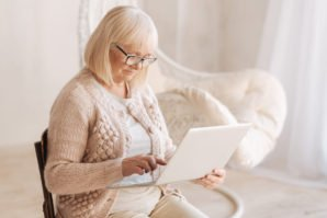 Older Woman using Touch Screen Laptop - Schiffman Law Office