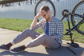 Man Searches Phone for Bike Repair Help - Schiffman Law Office